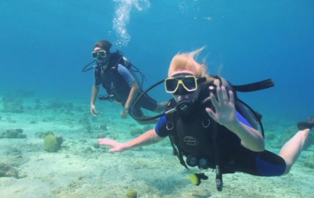 Unplugged and underwater: Mother and son dive in Curacao
